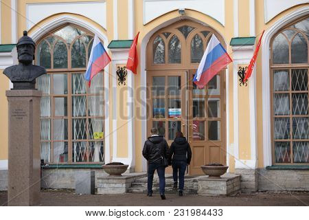 STRELNA, SAINT-PETERSBURG, RUSSIA - MARCH 18, 2018: People at the polling station during Russian Presidential elections. Vladimir Putin leading with about 70 percents