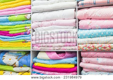 Bed Linen Is Beautifully Displayed On The Shelves For Sale In The Chinese Clothing Market
