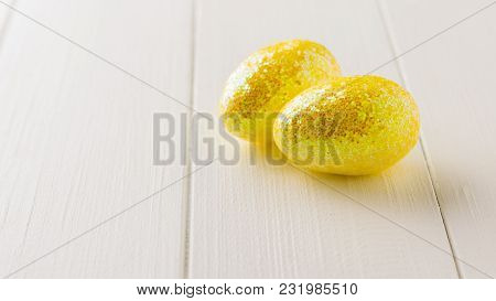 Two White Eggs On A Dark Wooden Table. The Decoration Of The Easter Table. Great Christian Holiday.
