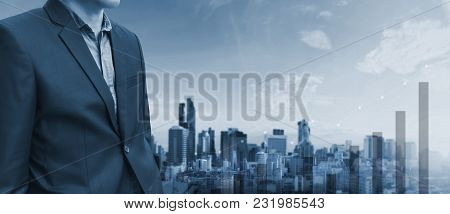 Businessman And Raising Graph Diagram With City Background. Business Growth And Investment