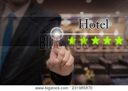 Businessman Pointing Five Star Button To Increase Rating Of Hotel Over Abstract Blurred Photo Of Con