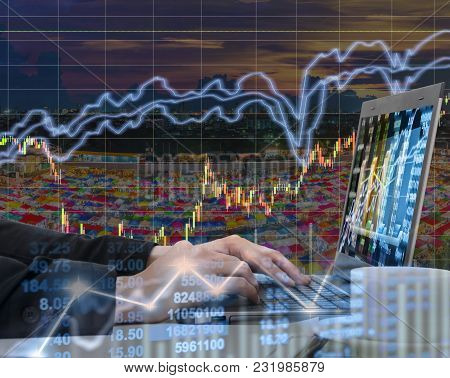 Businessman Using The Laptop Working With Stock Market Chart In Computer Screen Over The Stock Marke