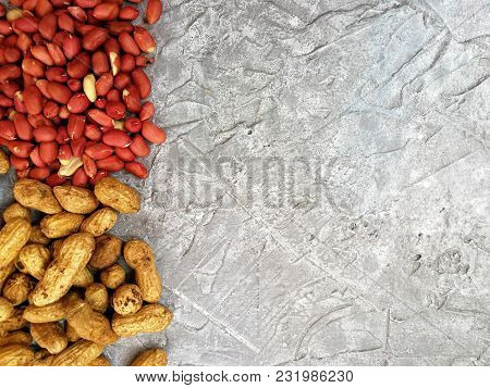 Walnut Peanut Excavation, Peeled And In-shell On A Gray Background