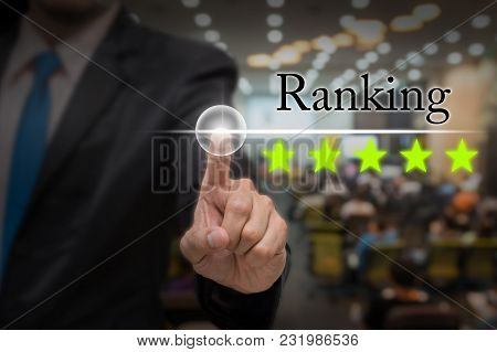 Businessman Pointing Five Star Button To Increase Ranking Of Hotel Over Abstract Blurred Photo Of Co