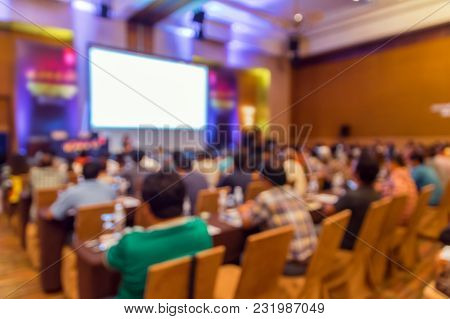 Blank Screen Of Display With Abstract Blurred Photo Of Conference Hall Or Seminar Room With Attendee