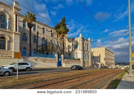 JERUSALEM, ISRAEL - DECEMBER 29, 2016:  Road along of Jerusalem Center St. Louis French Hospital with the the Virgin Mary, a replica of Our Lady of Salvation in Paris.