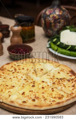 Meat ossetian pie on a table with georgian food