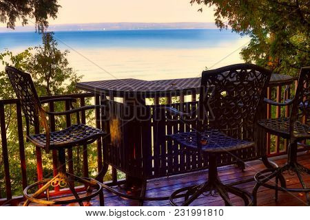Enjoy the view of Lake Michigan from an overlooking deck.  This view is between Petoskey and Charlevoix Michigan.
