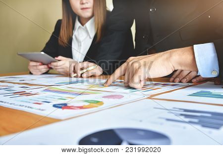 Close Up Business People Are Discussing With Chart Or Graph Documents At Meeting. Teamwork, Brainsto