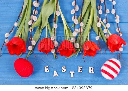 Fresh Red Tulips, Catkins And Eggs Wrapped Woolen String On Boards As Festive Easter Decoration