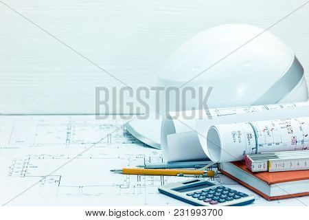Contractors Workplace Background. Drawing And Measuring Tools, Protective Helmet, Notebook, Blueprin