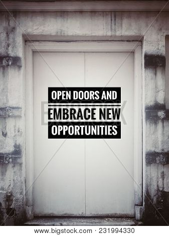 Motivational And Inspirational Quotes - Open Doors And Embrace New Opportunities. With Blurred Vinta