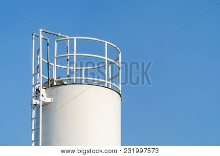 Large White Water Tank With Blue Sky Background.