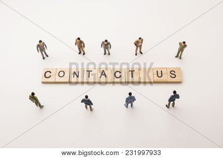 Miniature Figures Businessman : Meeting On Contact Us Letters By Wooden Block Word On White Paper Ba