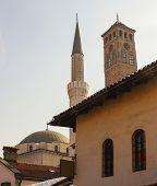Vew of the Gazi Husrev-bey minaret and the Clock tower called Sahat Kula in Sarajevo poster