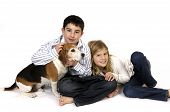 Boy and girl with pet dog on white. poster
