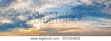 Dramatic Vibrant Color With Beautiful Cloud Of Sunrise And Sunset On A Cloudy Day. Panoramic Image.