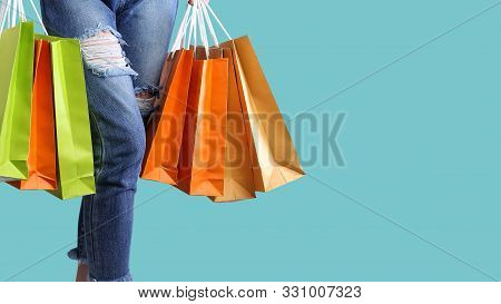 Shopping Bags On Women Hands On The Pastel Isolated Background