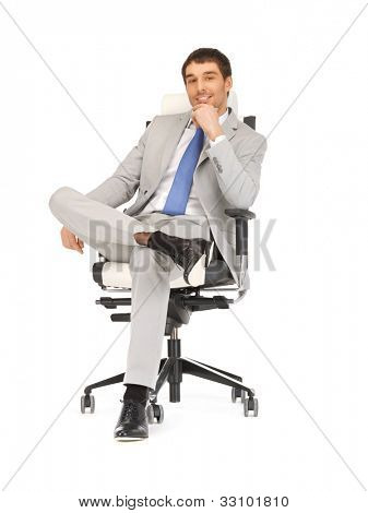 picture of young businessman sitting in chair