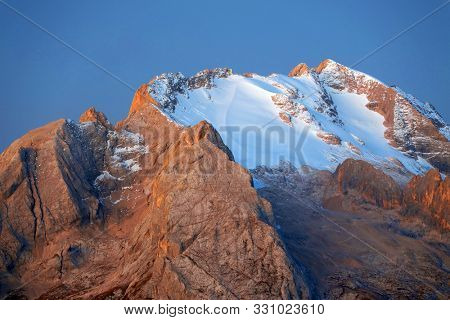 Colorful sunrise over Marmolada Peak - 3343meters, the highest mountain in the Dolomites, Italy