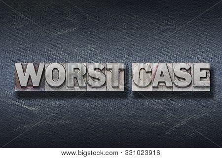 Worst Case Phrase Made From Metallic Letterpress On Dark Jeans Background