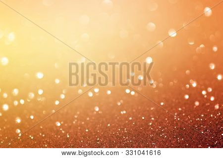 Abstract Orange Bokeh Background. Christmas Glittering Background. Abstract Christmas Background. Gl