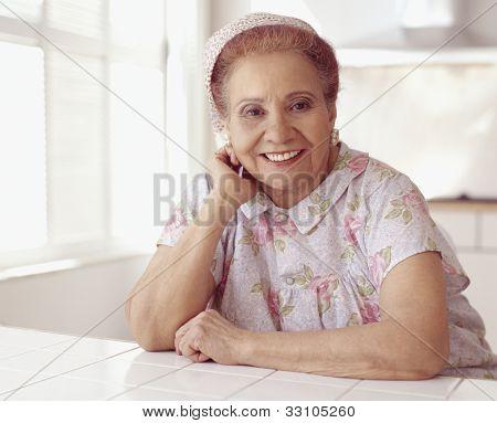 Senior Hispanic woman wearing housecoat