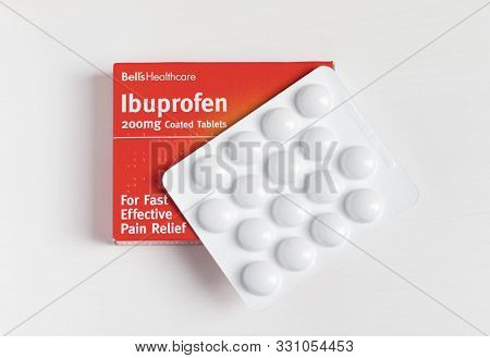 London / Uk - October 30th 2019 - Packet Of Ibuprofen Painkillers, Closeup With Blister Pack Of Tabl