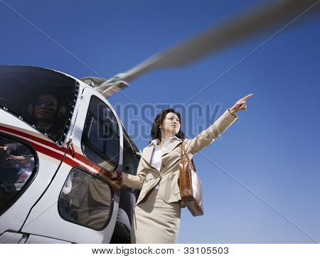 Asian businesswoman on helicopter