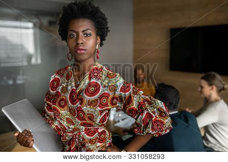 Beautiful Young Confident Professional Black African Business Woman Holding Laptop, Coworkers Hold A