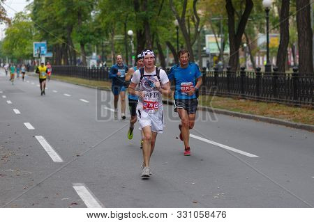 Dnipro, Ukraine - September 22, 2019: Unknown Participant Using Running Hydration Pack Running On Dn