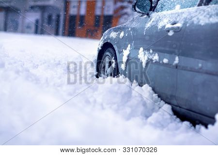 Winter Problems Of Car Drivers. Car On A Snowy Road. Car Stuck In Snow. Winter Day.