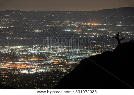 Night mountain view cityscape view from Rocky Peak Park in the San Fernando Valley area of Los Angeles, California.