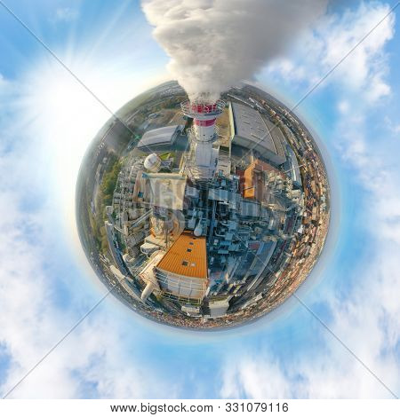 Aerial view to smoking chimmney from chemical plant. 360 degree panorama on air pollution and climate change theme. Heavy industry as a co2 emissions source.