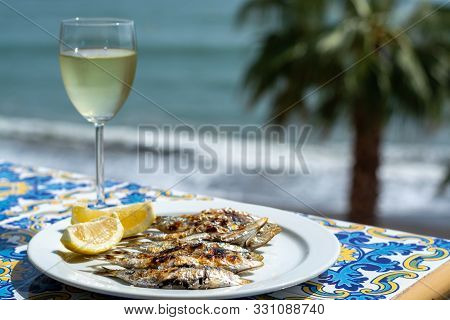 Espeto, Malaga Style Fish On Stick Barbecue Prepared On Olive Tree Firewoods And White Wine