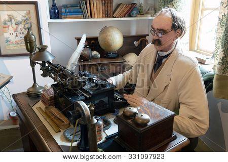 Brighton, United Kingdom - 8 October 2019: Model Or Wax Work Of Joseph Rudyard Kipling In His Office