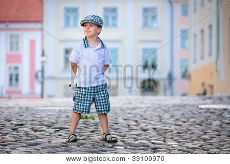 Portrait of a little 3 years old boy outdoors