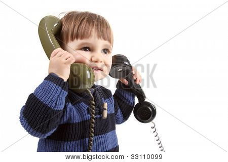 small child in a call center with two phones
