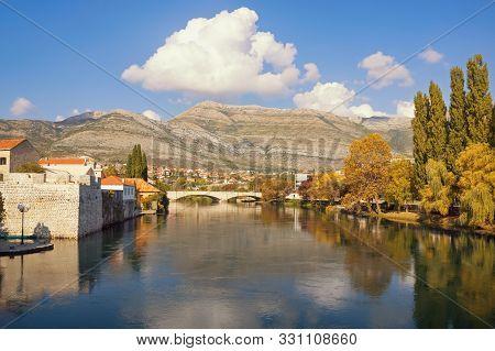 Sunny Autumn Landscape. View Of Trebisnjica River Near Old Town Of Trebinje City. Bosnia And Herzego