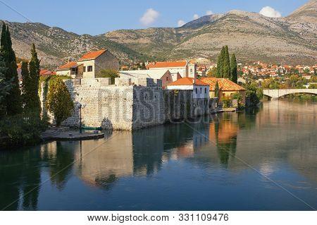 View Of Old Town Of Trebinje City And Trebisnjica River On Sunny Autumn Day. Bosnia And Herzegovina,
