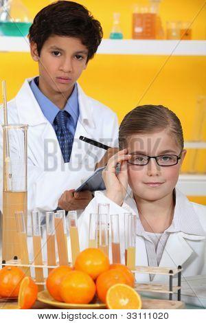 Children analysing orange juice