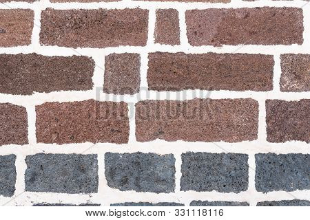 Old Brick Wall Background With White Grout In Joints