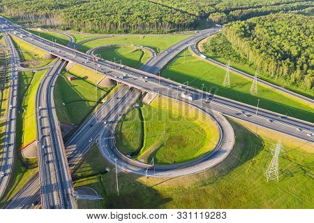 Top View Over The Highway, Aerial View Interchange Of A City, Shot From Drone, Expressway Is An Impo