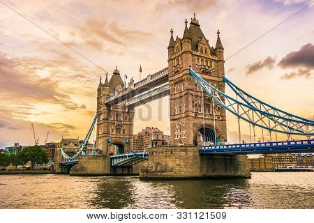Tower Bridge In London, The Uk. Tower Bridge Sunset Dusk. London Beautiful Wallpaper. Photo Stock