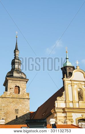Franciscan Monastery In Plzen, Czech Republic With Light Blue Sky In Background. The Church And Mona
