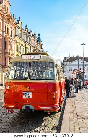 Pilsen, Czech Republic - Oct 28, 2019: Vintage Red Bus On The Main Square In Plzen, Bohemia, Czechia