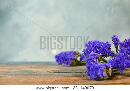 Blossom Brench Of Lavender Variety Flower On The Table. Background With Copy Space.