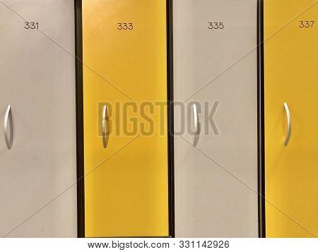 Background Texture: Yellow Lockers In The Locker Room. Lockers In A Public Locker Room.