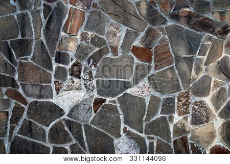 Slate stone wall mosaic texture in gray and brown colors