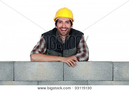 Portrait of a smiling stonemason